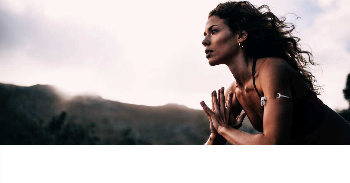 Woman exercising on a mountain