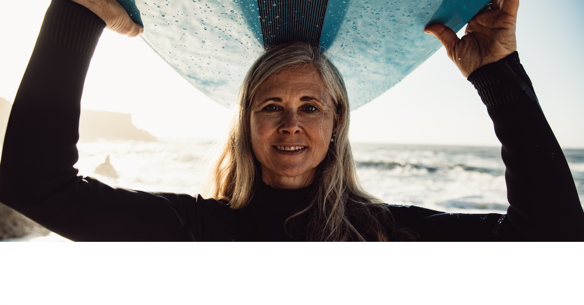 Retired woman with a surfboard